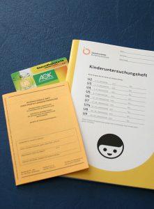 Versicherungskarte, gelbe U-Heft, Impfpass